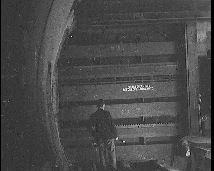 """From now on that man can do his worst. London's tube railways are safe."" Watertight doors are added to tube tunnels to protect them from air raids in 1939."